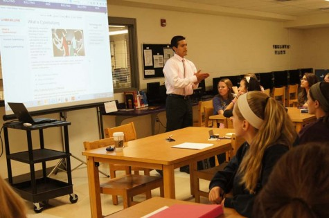 Principal Michael Schumacher shows a website to The Student Leadership Team about bullying.