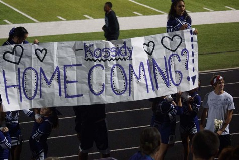 Senior Nathan Orel surprises junior Kassidy Wieduwilt with a homecoming proposal in front of the crowd on Sept. 11 at the home football game against Baldwin.