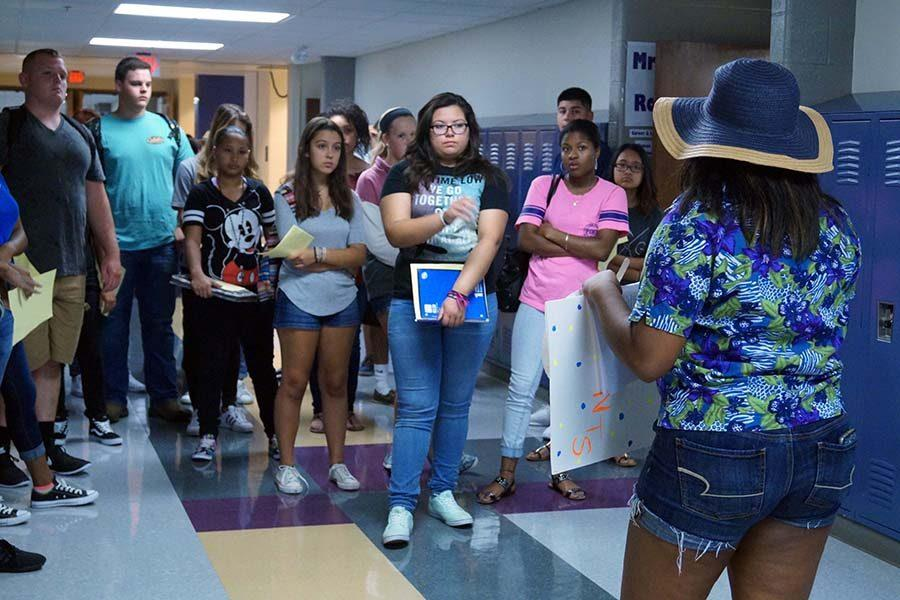 Senior Ariana Williams leads new students in a tour of the school.