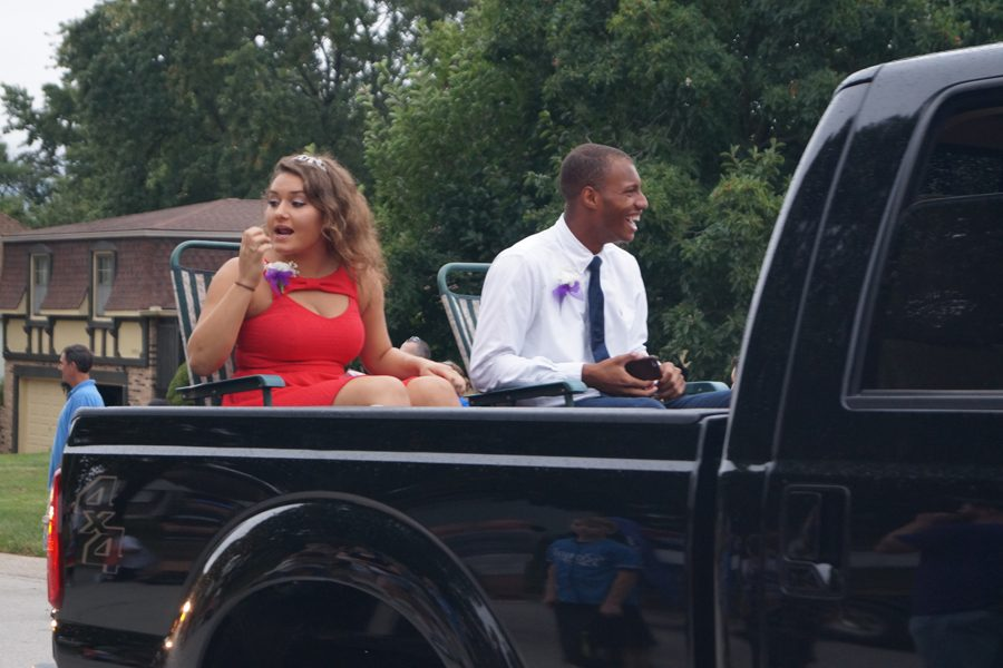 Seniors+Shaylee+Kane+and+Emmett+Lockridge+ride+in+the+2015+Homecoming+parade.+The+junior+class+prince+and+princess+are+candidates+for+Homecoming+king+and+queen+this+year.