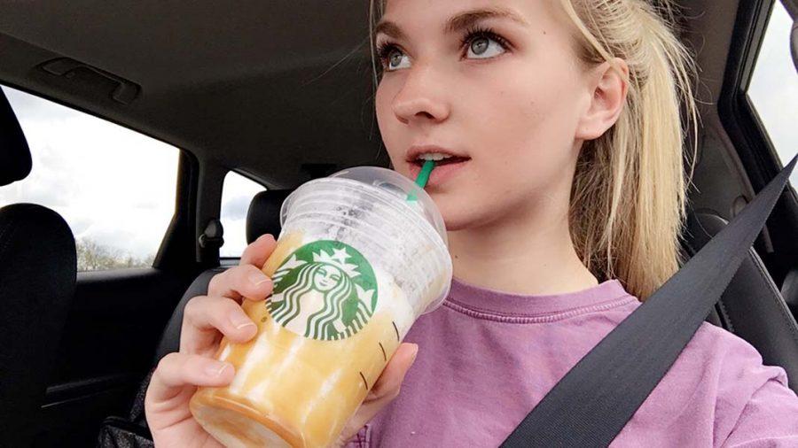 Sophomore Taran Kerst poses for a selfie while drinking Starbucks.