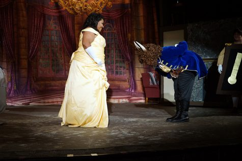 Beast (senior Ian Smith) bows at Belle's feet out of respect before they dance.