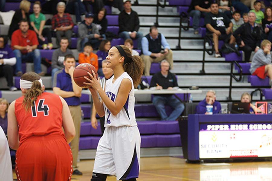 Sophomore LaKya Leslie shoots a free throw in the girls' 92-20 win over Ottawa.