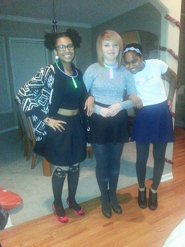 Juniors Vanilla Davis (far right), Diana Sifuentez (middle) and friend participate in an annual New Year's Eve party.