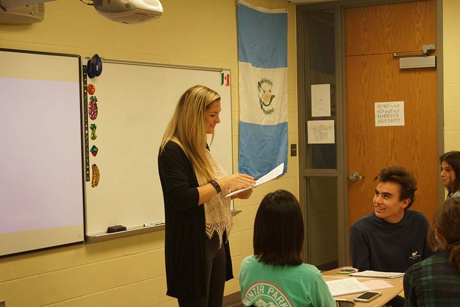 Elizabeth Schmeltzer smiles along with Spanish 3 students as she teaches.