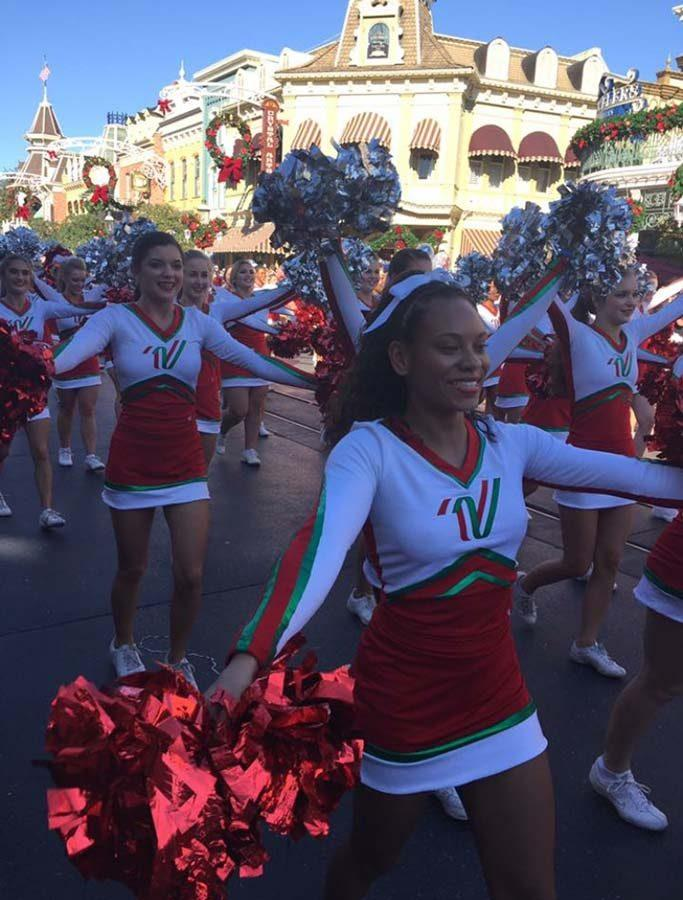 Talia performs alongside fellow All-American cheerleaders in the NCA's Disney Parks parade in Orlando.