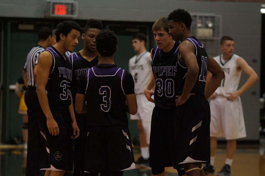 Boys%27+varsity+basketball+takes+the+win+against+Basehor