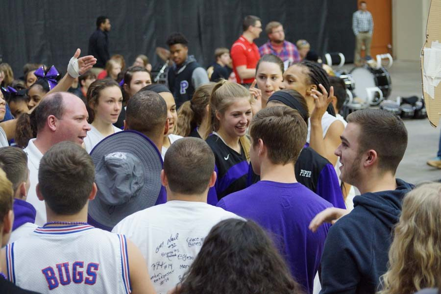 The girls' basketball team and the student section celebrate their 45-34 win against Abilene.