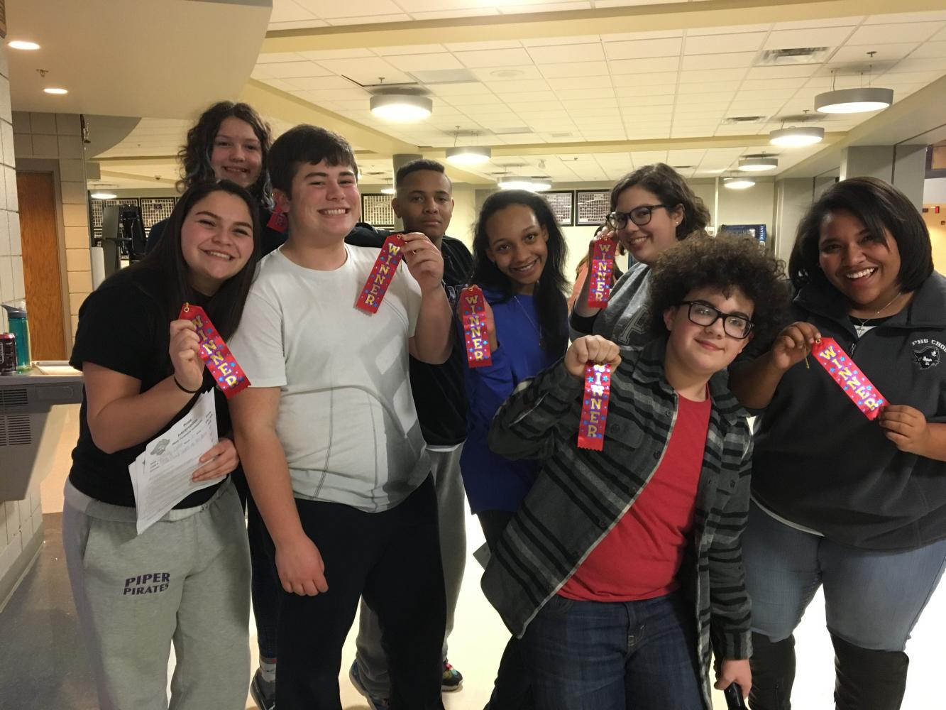 The forensics lock-in Jan. 20 included a mock tournament. These novices took first in their individual events. From left: Olivia Ortiz, Martha Wolf, Drew Novak, Kaulon Eason, Eden Barnes, Emma Bertrand, Trent Smith, and Alena Riley.