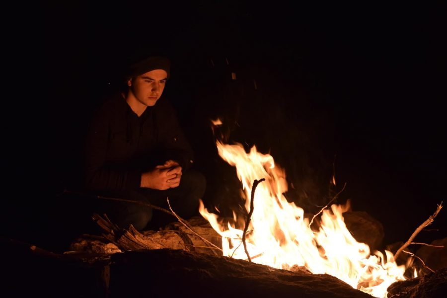 Part of Senior Gabe Pappert's senior project is learning to make a fire.
