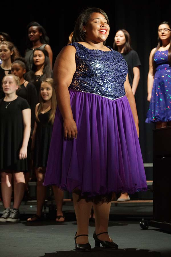 Junior Alena Riley sings her solo at the choir concert April 17.