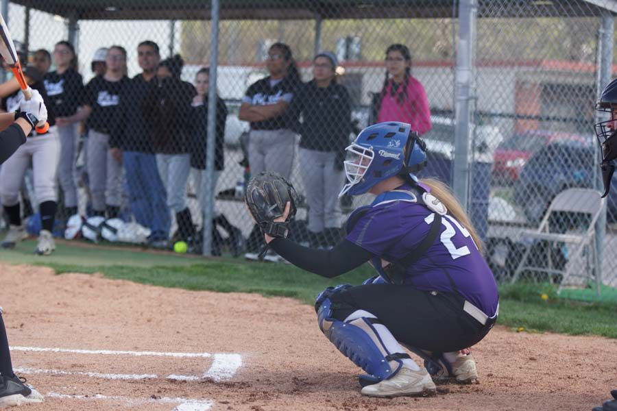 Junior Kamryn Sparks catches for pitcher Makayla Stack in the first game against Bishop Ward.