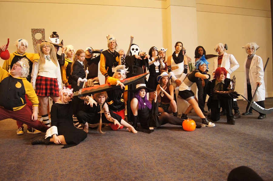 A group of anime fans in cosplay pose for pictures at Naka Kon.