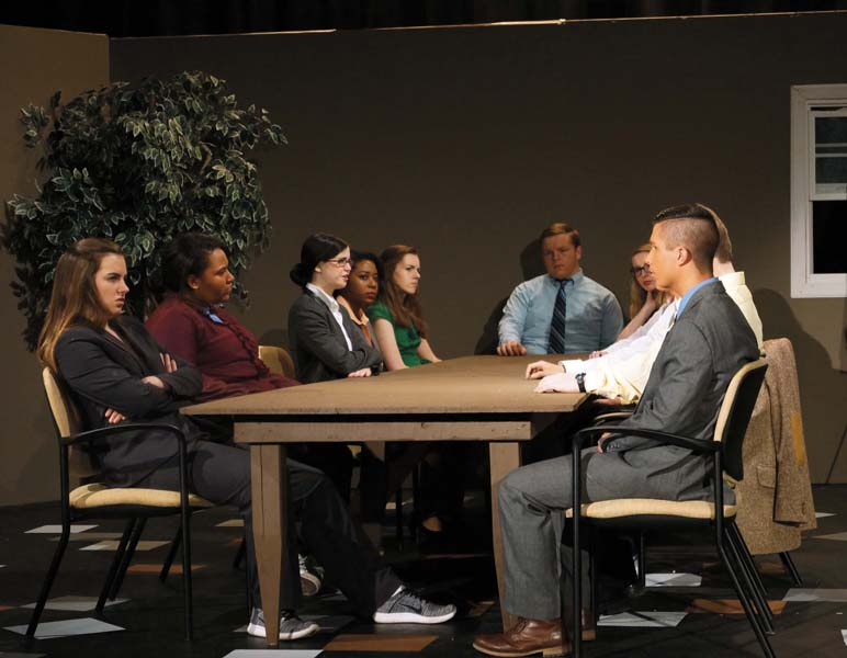 All twelve jurors discuss the case of the murder.