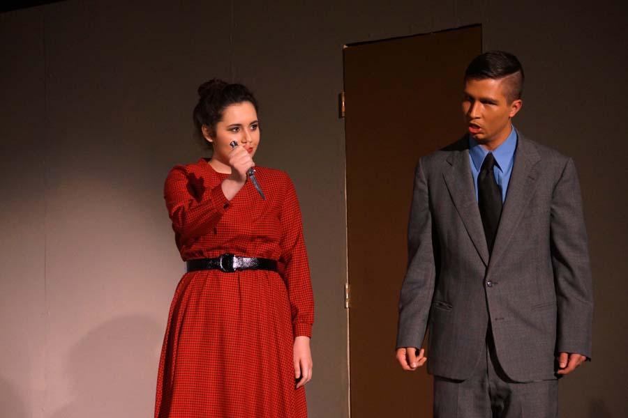 Senior, Skylar Penyweit, shows junior, Isaia Wilcoxen, the murder weapon.