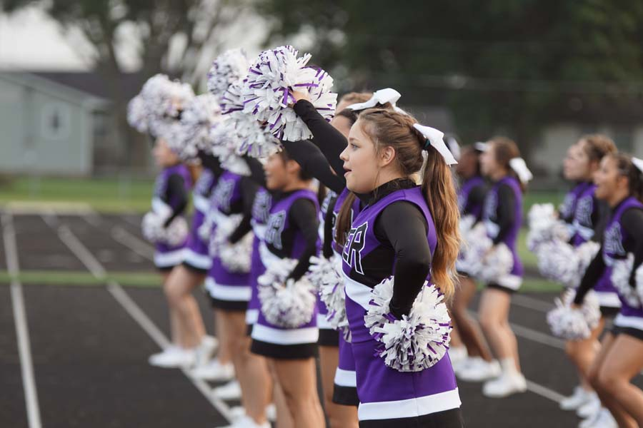 The cheer team keeps the crowd's spirit up as the game goes on.