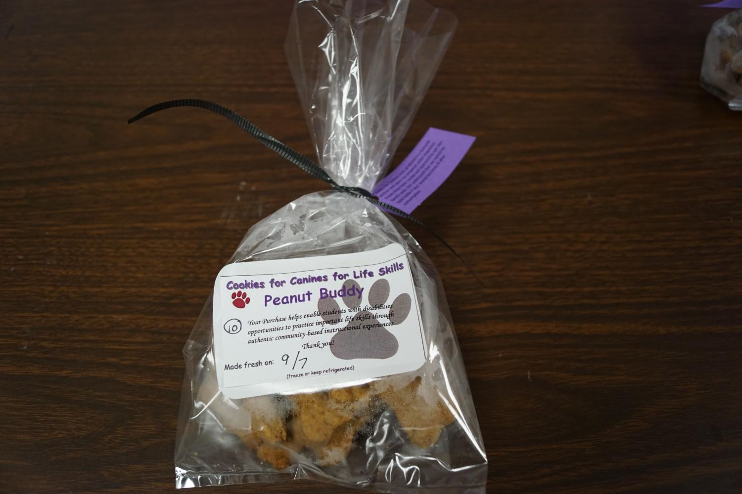 The life skills class prepares and packages their own dog treats as a fundraiser.