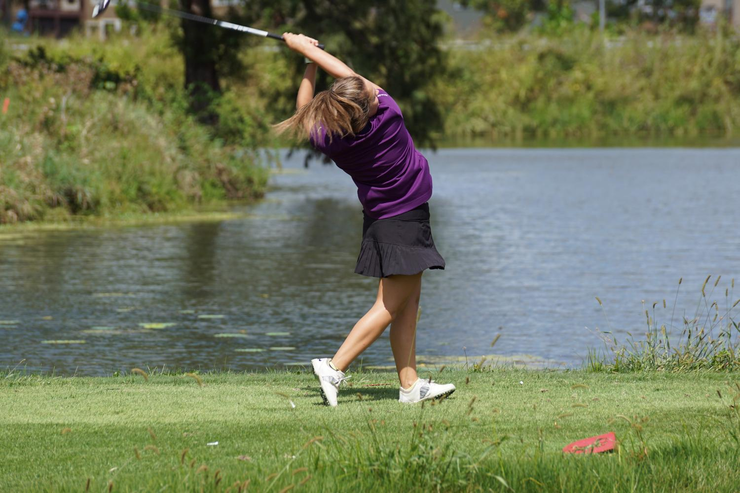 Sophomore Sydney Rhodes swings at Spring Hill's tournament.