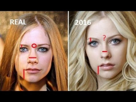 Conspiracy theorists compare Avril Lavigne before and after 2003 to prove the theory real.