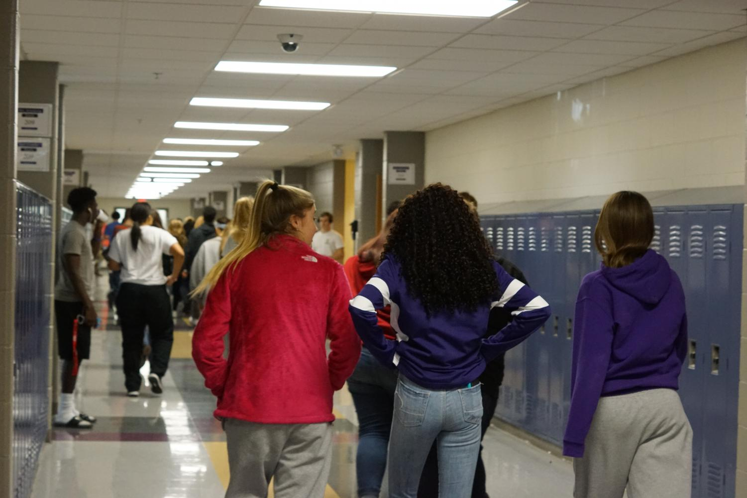 Students walk the halls after being dismissed from lunch.