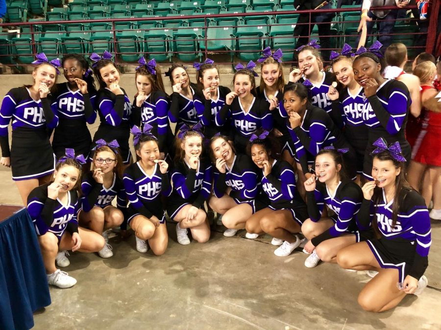 The cheer team poses for a picture after earning fourth place at KSHSAA cheer competition Nov. 18 at the Topeka Expocentre