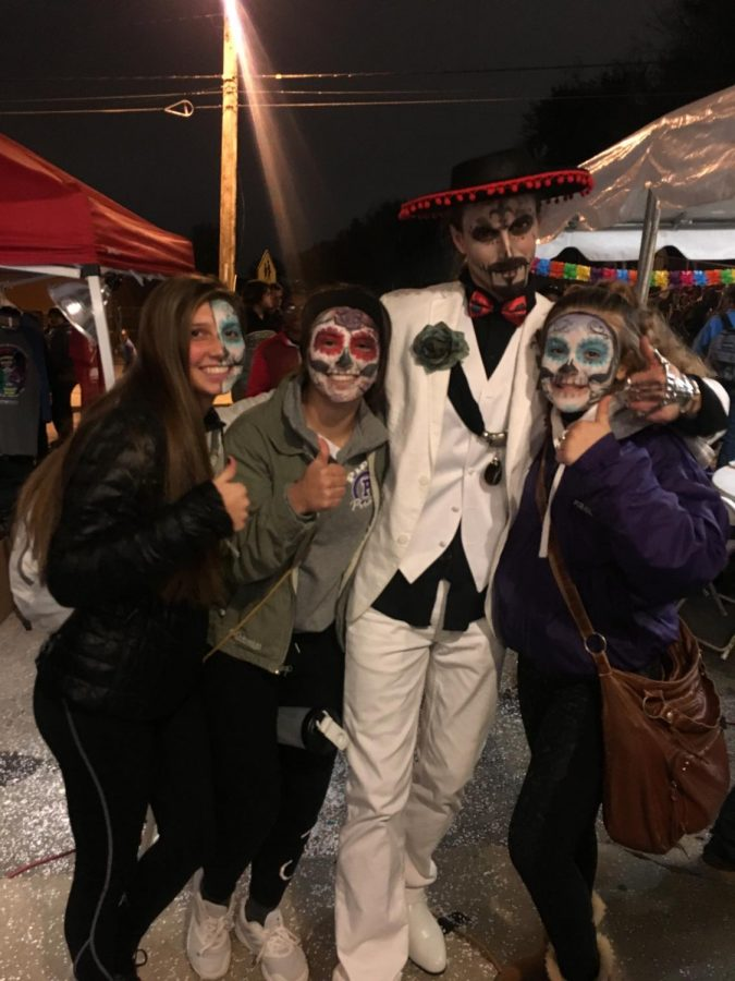 Juniors Emma Johnson, Shelby Rome and Hannah Pappert attend the Day of the Dead festival at Mattie Rhodes Art Center.