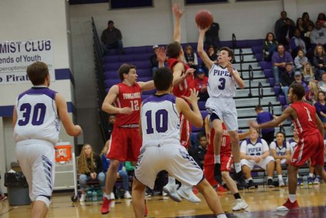 Junior Kaleb Brown goes for the one-handed lay up.