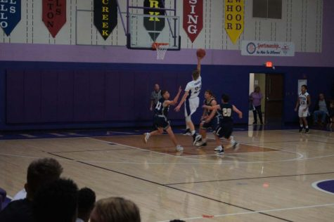 Sophomore Brendyn Bard beats the buzzer at the end of the first quarter to extend the Pirates' lead over Hayden in the JV game on Dec. 12.