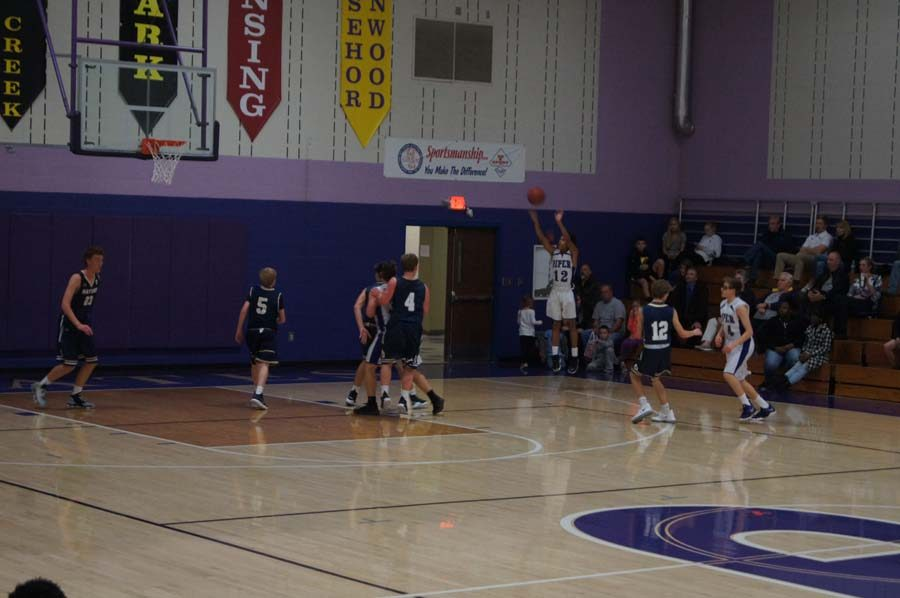 Freshman Jami Tyson shoots an open three-pointer late in the second quarter of the JV game against Hayden.