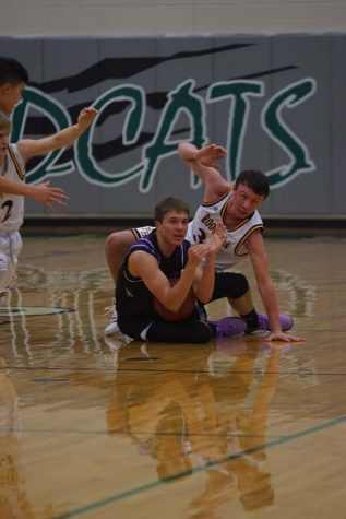 Senior Bryce Yoder signals his coach to call a timeout after winning possession of the ball.