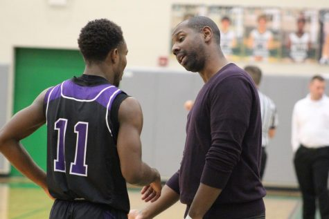 Coach Touré Grimes talks to Junior Trey Bates after subbing him out of the game.