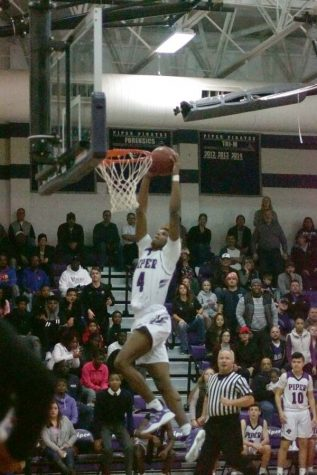 Braijion Barnes leaps to the goal going for a dunk.