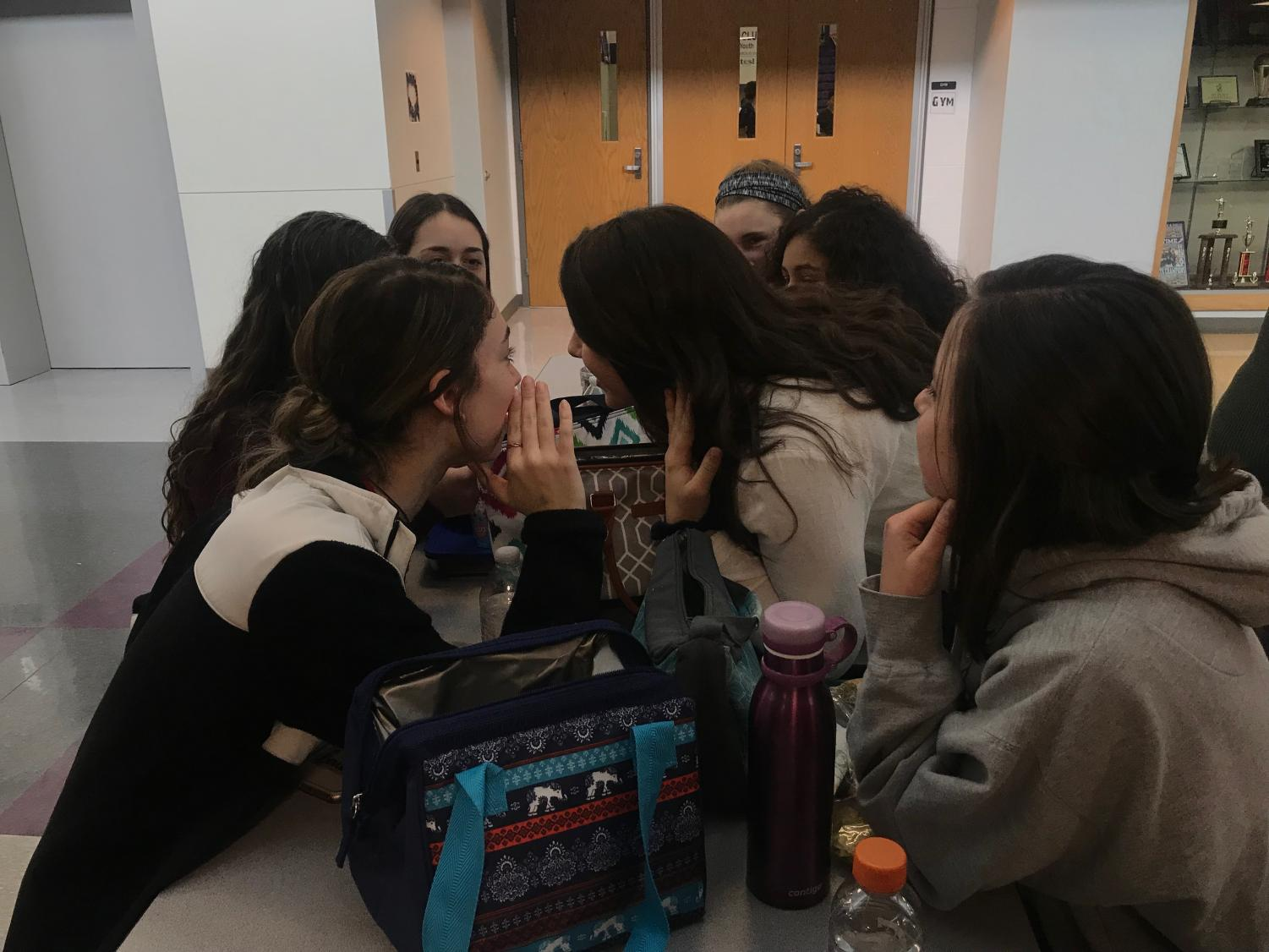Students converse about news during lunch time.