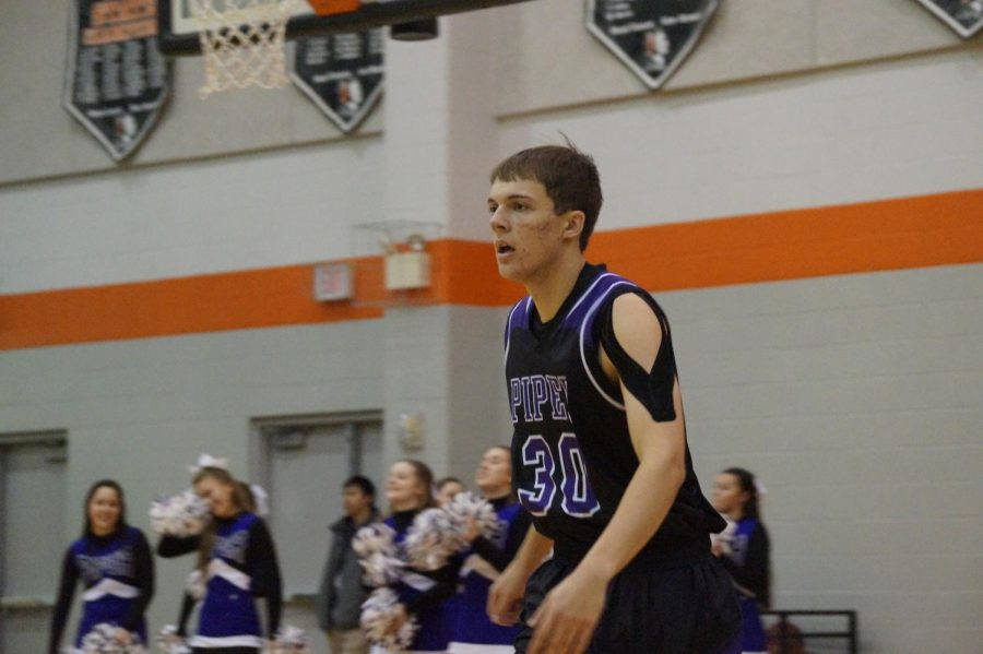 Senior Bryce Yoder begins to rush down the court as Piper gains possession of the ball Jan. 12.
