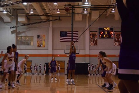 Junior Ryan Cobbins swishes a free throw after being fouled.