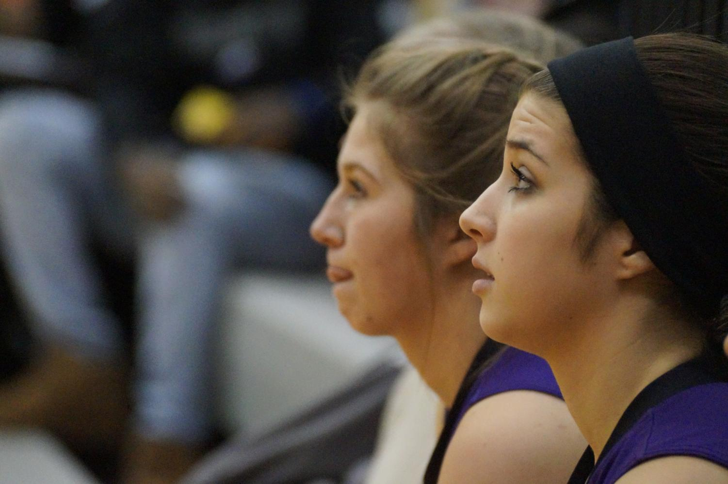 Senior captain Mary Rogers and and junior Emma Serrano focus on the Pirates' victory Jan. 12.