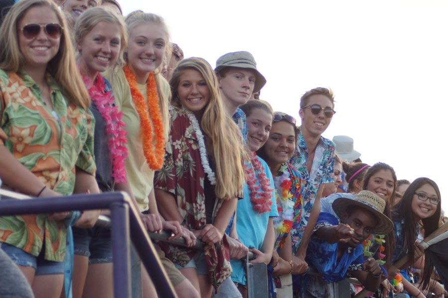Seniors take the lead at home games, filling the front rows and keeping school spirit high. The Pirates hosted Lansing in football Sept. 22, and the student section theme was Hawaiian.