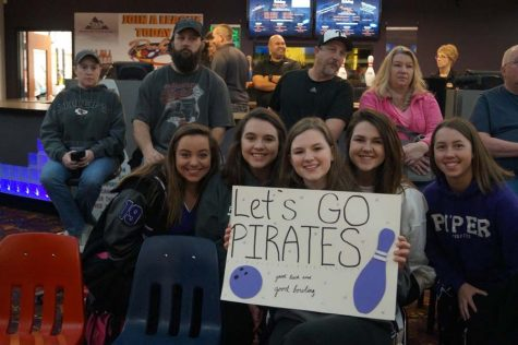 The girls' team showed up early to the boys' game to show their support before competing that afternoon.