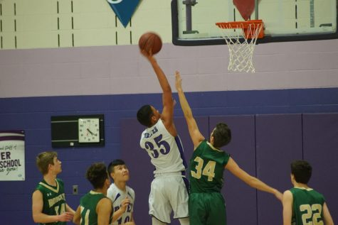 Sophomore Christian Arndt gets fouled as he goes up and makes a layup