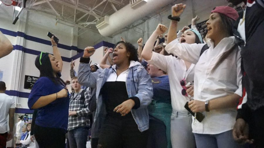 The seniors cheer during the Pirate countdown at the courtwarming pep assembly Feb. 9.