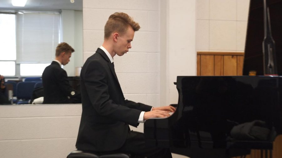 Sophomore Philipp Bretschneider warms up before performing in front of the judge at the regional piano festival Feb. 3.