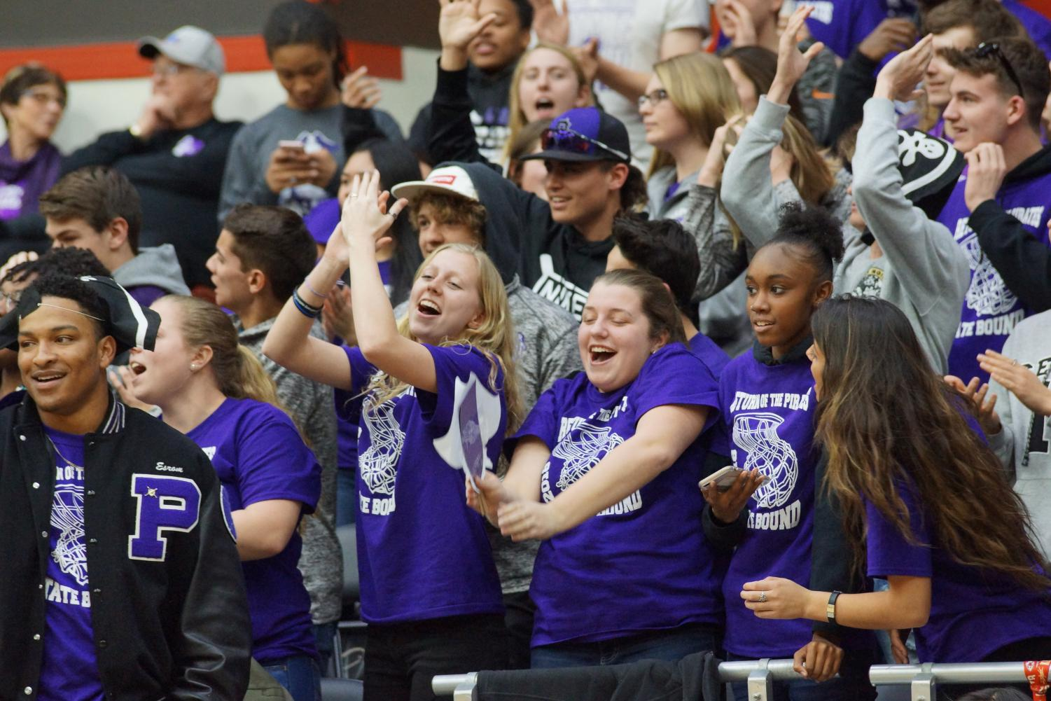 The crowd cheers and celebrates the Pirates 57-42 win against the Paola Panthers at game  one of the state tournament.