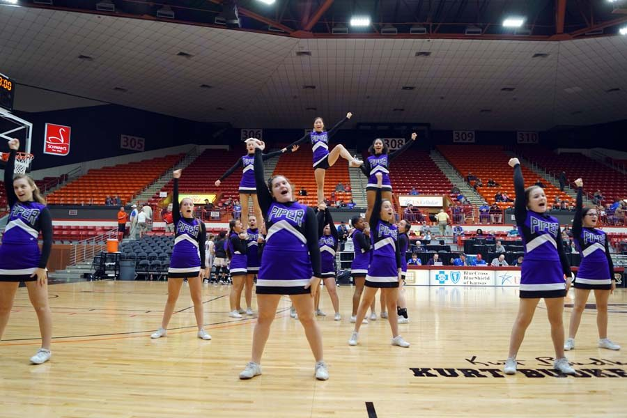 The Piper cheer team preform for the student section during halftime.