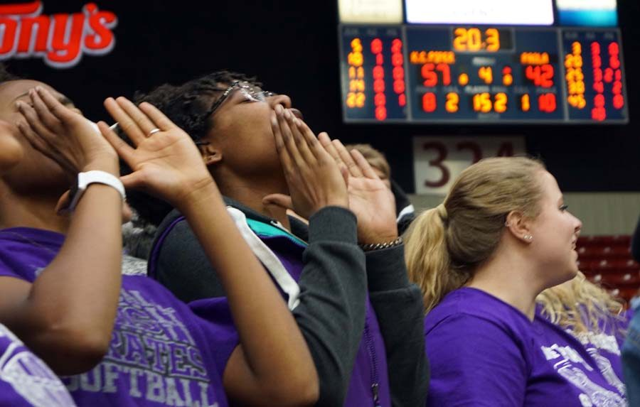 Junior Jada Simmons and the student section cheer for the victory of the Lady Pirates in the game Wednesday night.