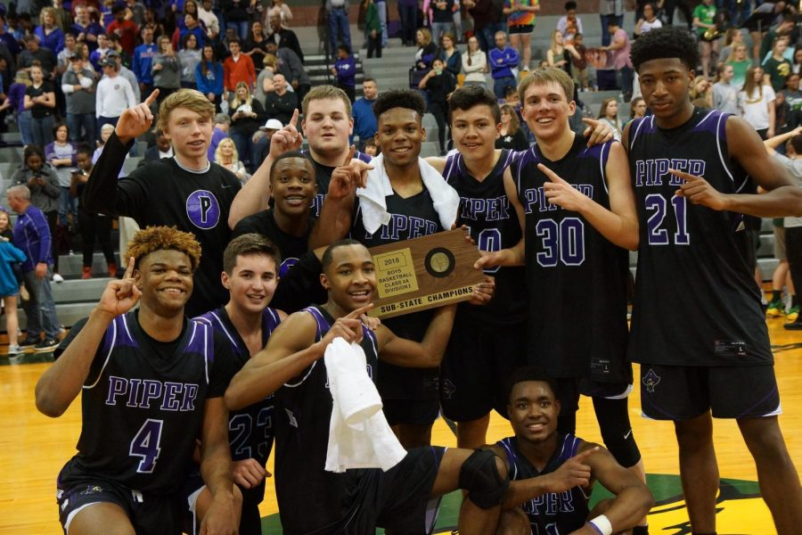 The Pirates pose for a photo after winning the sub-state game against Basehor