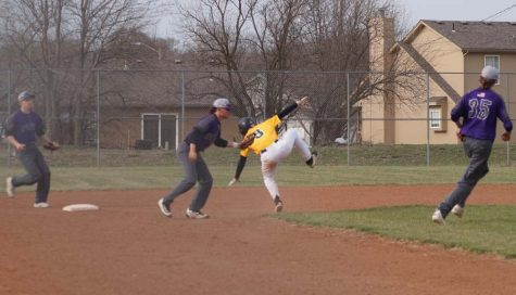 Junior Kimball Backus gets the base runner out after being in a pickle between second and third base.