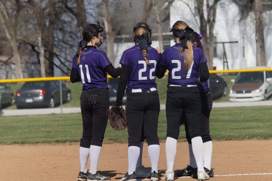 JV Pirates discuss their game plan for the inning before they defeat Ottawa, April 17