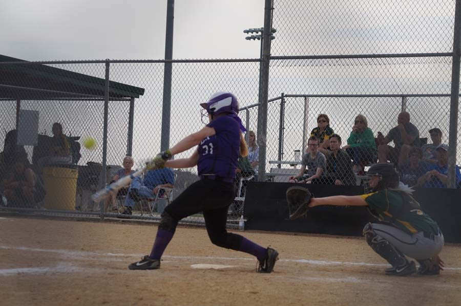 Freshman Kaylee Spencer hits the ball out to the outfield scoring two runs against Basehor.