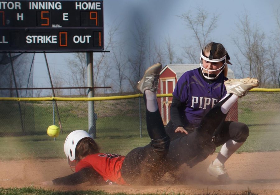 Junior Macey Nigh attempts to tag the runner out on third, yet loses the ball
