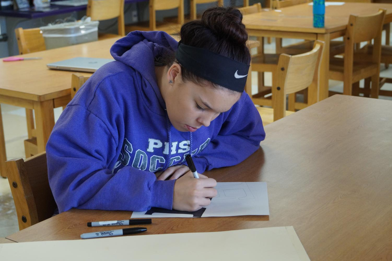 Senior Emma Morgan works in the library.